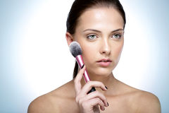 Beautful woman holding cosmetic brush Stock Photos