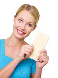 Beautful woman with the white bar of chocolate Royalty Free Stock Images