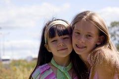 Beauti girls. Beauti sister happyon meadow royalty free stock photo