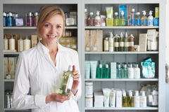 Beautician Advising On Beauty Products. Portrait Of Beautician Advising On Beauty Products Stock Photo