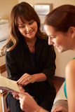 Beautician Advising Female Client On Beauty Products Royalty Free Stock Images