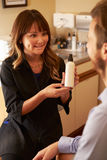 Beautician Advising Male Client On Beauty Products Royalty Free Stock Images