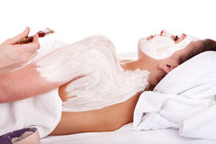 Beautician apply mask to girl. Massage. Royalty Free Stock Photos