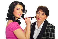 Beautician applying brush to model Royalty Free Stock Photography
