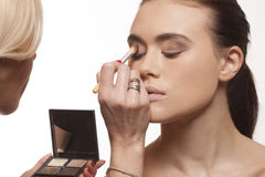 Beautician applying eye makeup Stock Photo