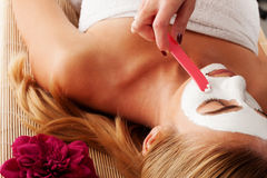 Beautician applying a face mask Royalty Free Stock Image