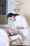 Beautician applying facial mask Royalty Free Stock Image