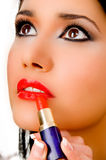 Beautician applying lipsticks on female's lips Royalty Free Stock Photos