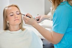 Beautician Applying Make Up To Woman Royalty Free Stock Photography