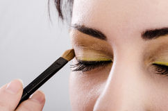 Beautician artist applying makeup Stock Photography
