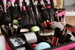 Beautician case with professional makeup products and tools on dressing table royalty free stock photography