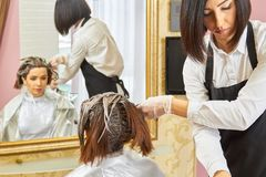 Beautician and client, hair dying. Inside beauty salon. Become a hair color specialist stock image