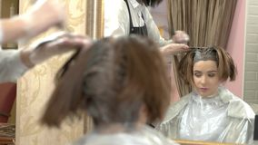 Beautician and client, hair dying. Inside beauty salon. Become a hair color specialist stock video footage