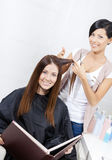 Beautician cuts hair of woman in beautician's Royalty Free Stock Photography
