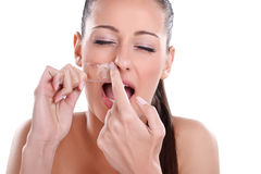 Beautician depilating a woman. Beautician depilating, young woman getting waxing mustache Stock Photos