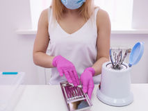 Beautician disinfect professional tools. Disinfection in manicure. Salon care for beauty and health stock photos