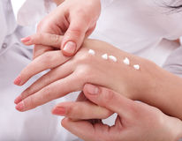 Beautician do  massage hand. Stock Photography