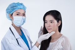 Beautician Doctor Check Diagnose Face structure patient before p stock images