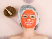 Beautician does cosmetic mask on the patient's Stock Images