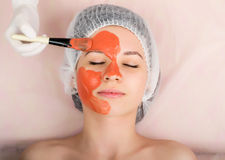 Beautician does cosmetic mask on the patient's Royalty Free Stock Photo
