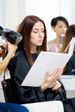 Beautician does hair style for woman in hairdressing salon Royalty Free Stock Photography