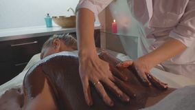 Beautician Doing Massage With Chocolate To Young Beautiful Woman At Spa Salon Stock Video Footage