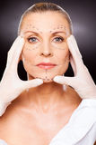 Beautician skin check Stock Photography
