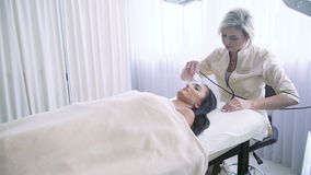 Beautician doing ultrasonic face treatment at beauty spa stock video