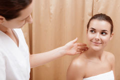 Beautician examines the face Royalty Free Stock Image
