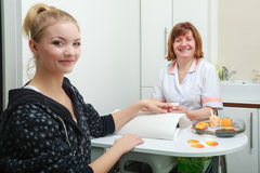 Beautician with file filing nails female client in beauty salon Royalty Free Stock Photography