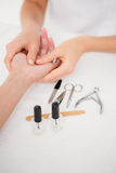 Beautician filing female clients nails at spa beauty salon Royalty Free Stock Photos