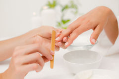 Beautician filing female clients nails at spa beauty salon Royalty Free Stock Photography