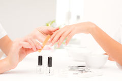 Beautician filing female clients nails at spa beauty salon Stock Image