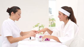 Beautician filing female clients nails at spa beauty salon stock video