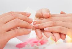 Beautician filing the nails of woman Royalty Free Stock Image