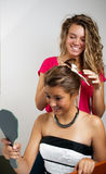 Beautician fixing girls hair Royalty Free Stock Photography