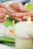 Beautician Giving Manicure Treatment Royalty Free Stock Photos