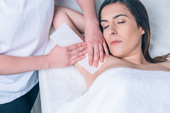 Beautician hands doing depilation in woman armpit Royalty Free Stock Images