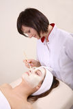 Beautician and her client stock photos