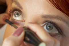 Beautician Is Doing Make-up To Red-haired Girl Stock Image
