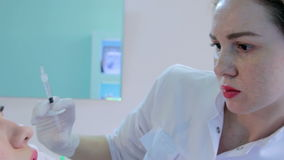 Beautician make injection plastic lips stock footage