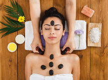 Beautician make stone massage spa for woman at wellness center Royalty Free Stock Photography