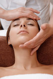 Beautician makes face massage Stock Image