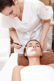 Beautician makes mask to a client Royalty Free Stock Image