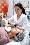 Beautician makes the procedure Royalty Free Stock Image