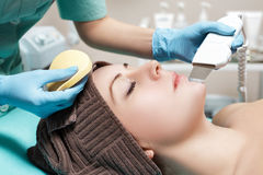Beautician makes Ultrasonic cleaning of face. cosmetology Stock Images