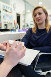 Beautician making manicure. Beautician doing file your nails Stock Image