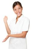 Beautician / massage therapist showing on white stock photo