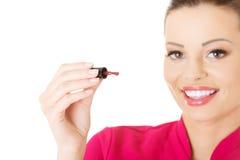 Beautician with nailwear. Closeup. Stock Photos