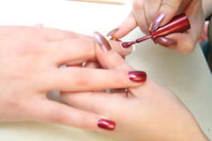 Beautician painting nails Royalty Free Stock Photos